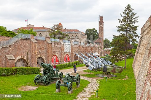 Belgrade, Serbia - May 24 2019: Old demilitarized cannons, tanks and missiles at Kalemegdan Park in front of the entrance to the Military Museum of Belgrade. The museum is located within the fortified walls of the Belgrade Fortress.