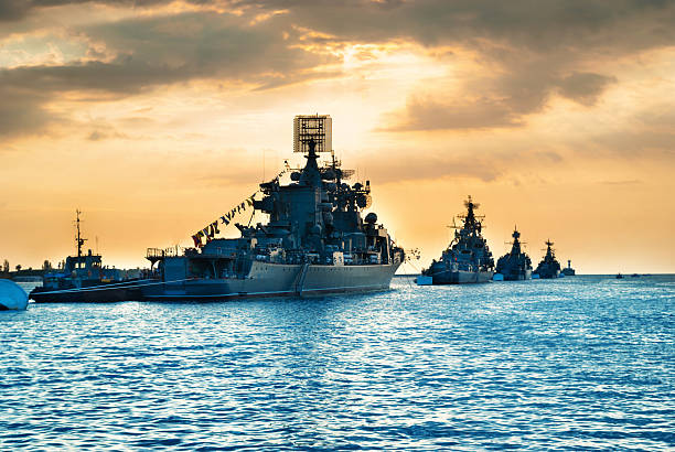 Military navy ships in a sea bay - foto stock