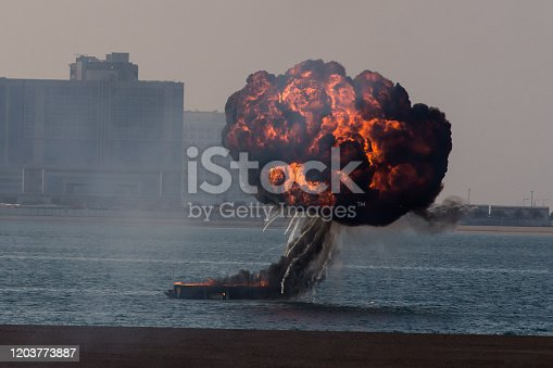 Military navy strike or bomb in war causes fire ball and explosion amid chaos in the water. Military war concept. Strength, power, force, fire, explosion. Close up.