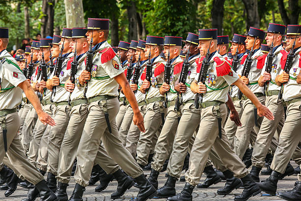 Military parade during national day Paris, France -  July 14, 2016 : Military parade during the ceremonial of french national day, Champs Elysee avenue. military parade stock pictures, royalty-free photos & images
