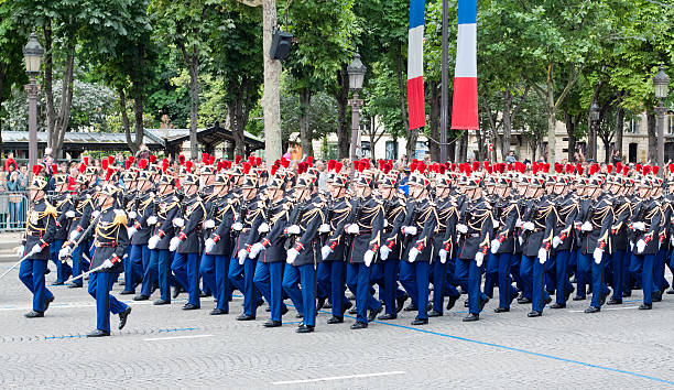 Military  parade in Bastille Day Paris, France - July 14, 2012: Army columns marching at a military parade in  Republic Day (Bastille Day) on Champs Elysees. military parade stock pictures, royalty-free photos & images
