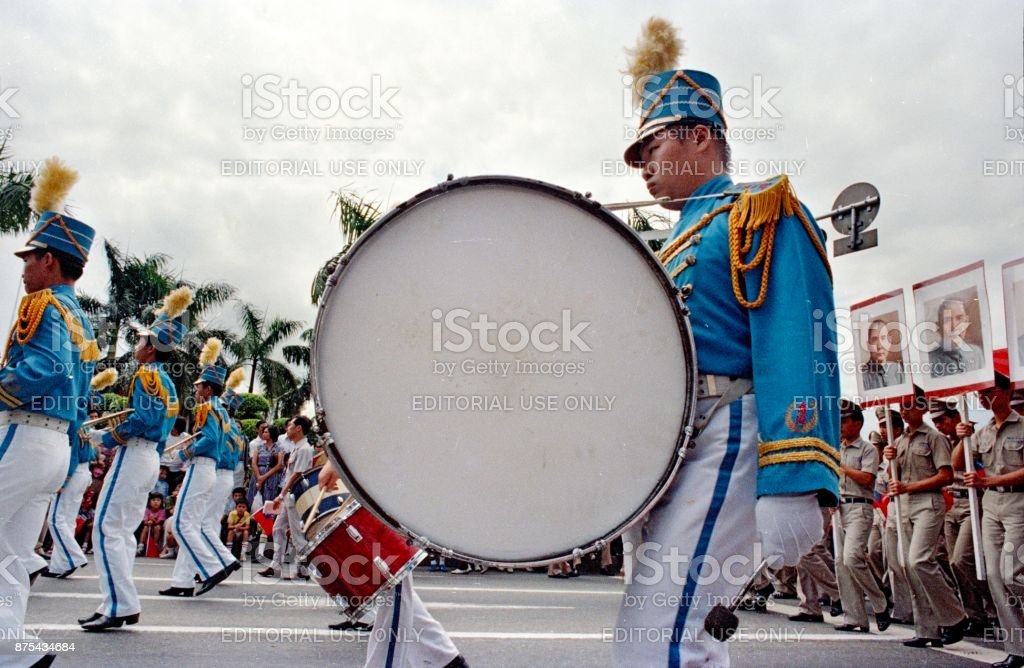 1980 military parade in China, a very serious man walks with his big drum stock photo