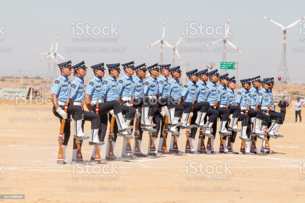 Military parade. Indian Guard show skill with a rifle contest as part of Desert Camel Festival in Jaisalmer, Rajasthan, India stock photo