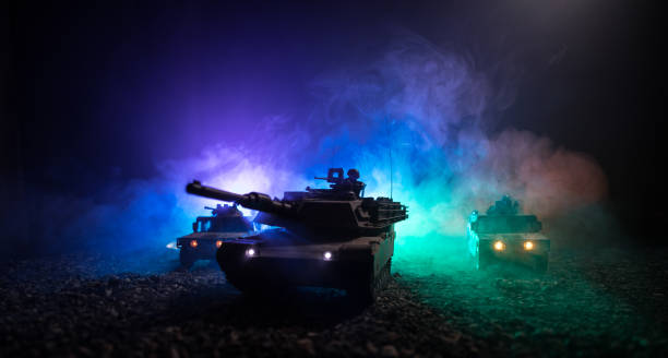 Military patrol car on sunset background. Army war concept. Silhouette of armored vehicle with soldiers ready to attack. Artwork decoration. Selective focus – zdjęcie