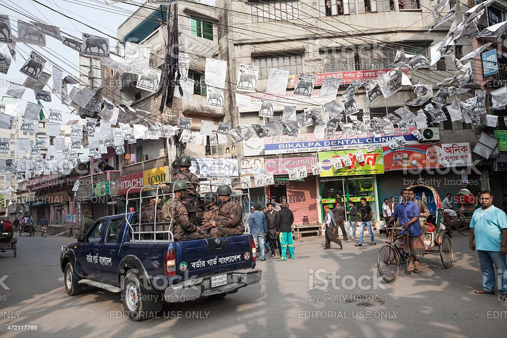 Military patrolling the streets stock photo