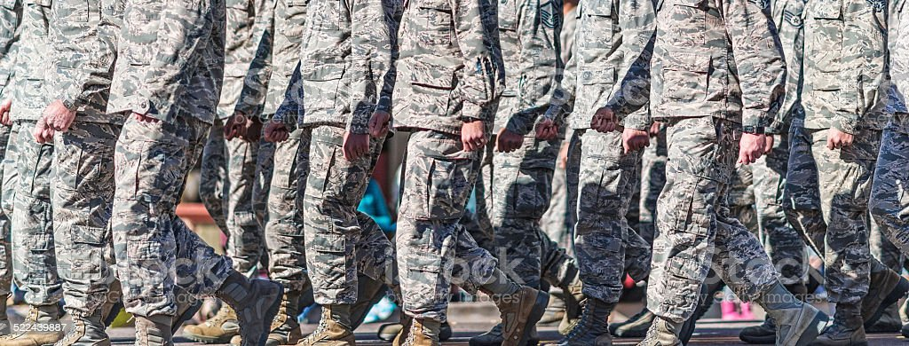 US Military personnel walking in formation stock photo