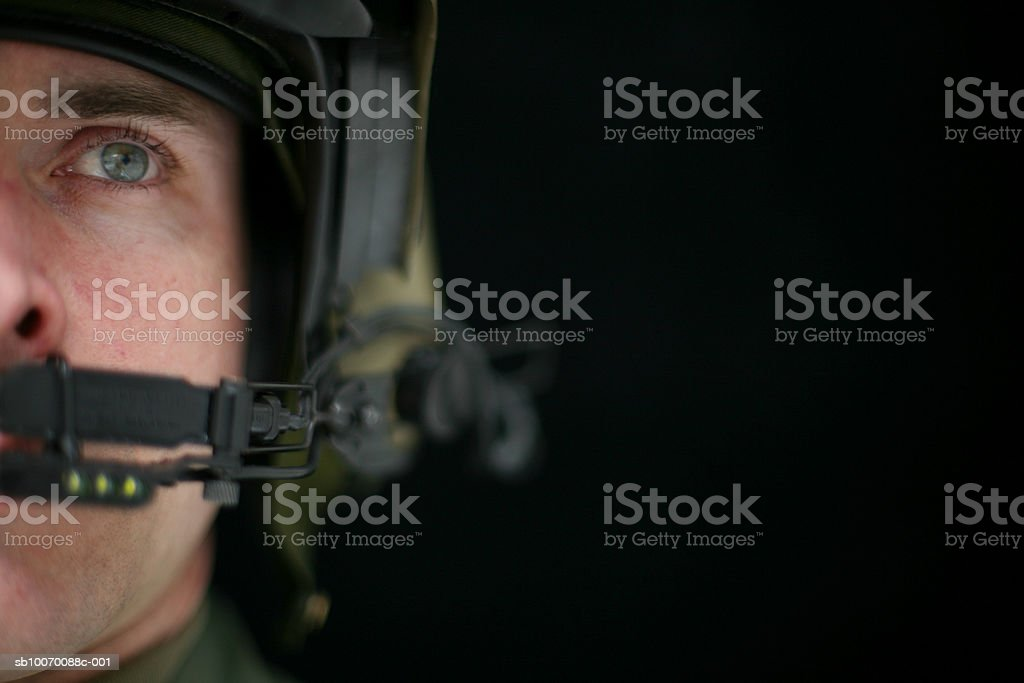 Military pilot wearing helmet, close-up foto royalty-free