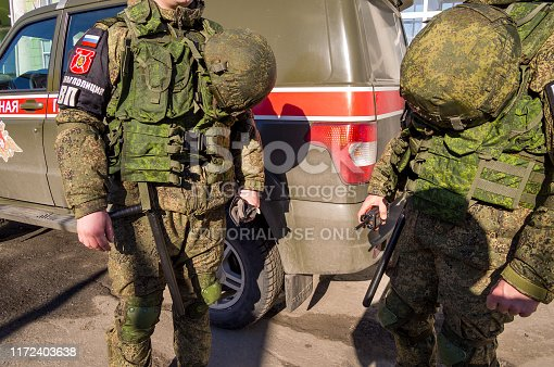 istock Military police officers stand by the car 1172403638