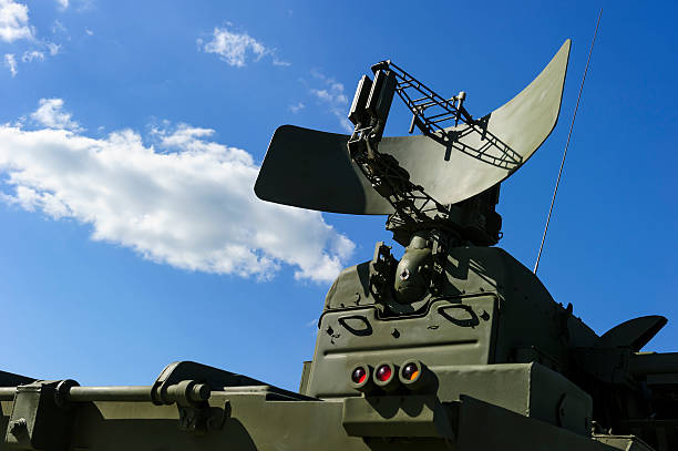 Military radar Air defense radar of military mobile mighty missile launcher system of green color, modern army industry, white cloud and blue sky on background  antiaircraft stock pictures, royalty-free photos & images
