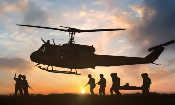 Military rescue helicopter during sunset Military rescue helicopter during sunset military attack stock pictures, royalty-free photos & images