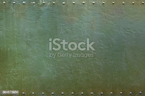 Riveted military or industrial plate. Metal background.