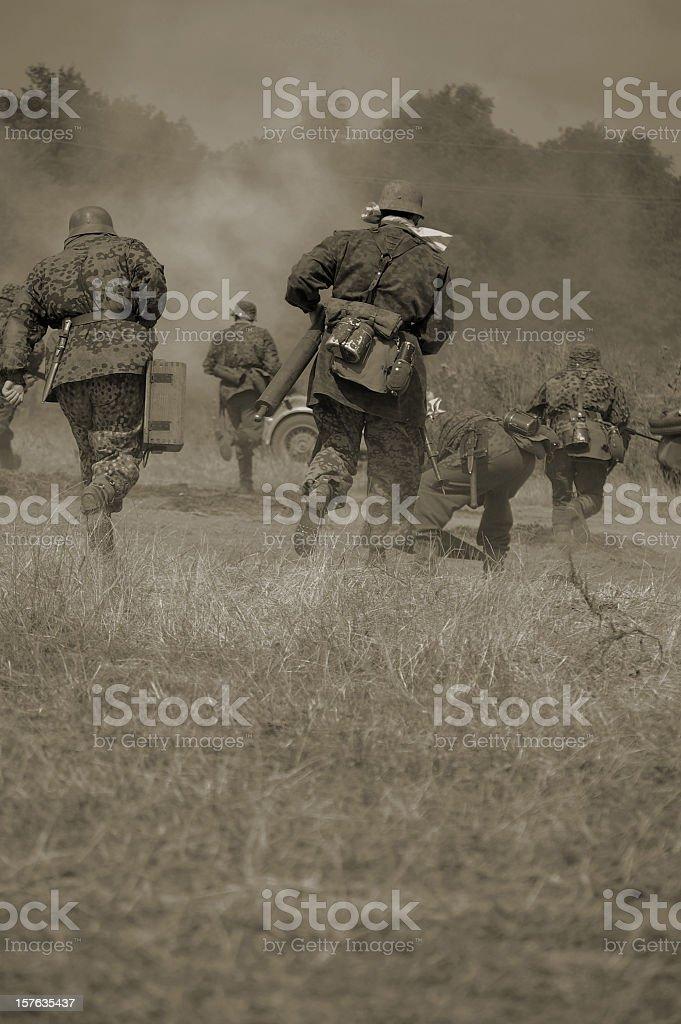 Military running in sepia tones stock photo
