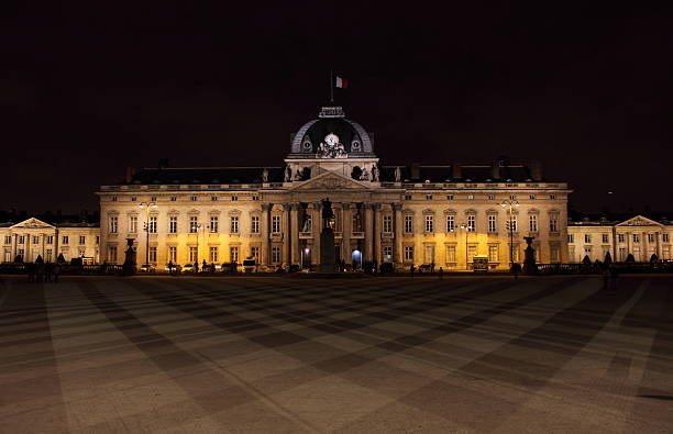 Military School by night in Paris The Military School (Ecole Militaire, 1750) by night in Paris, France ecole stock pictures, royalty-free photos & images
