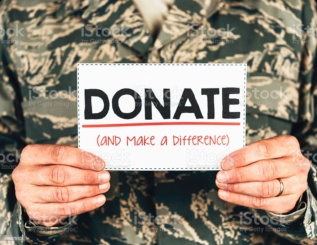 Military service member with donate sign stock photo