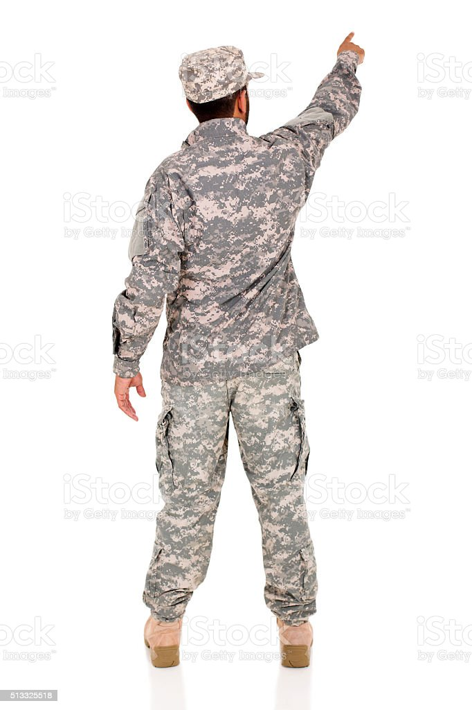 military serviceman pointing empty space stock photo