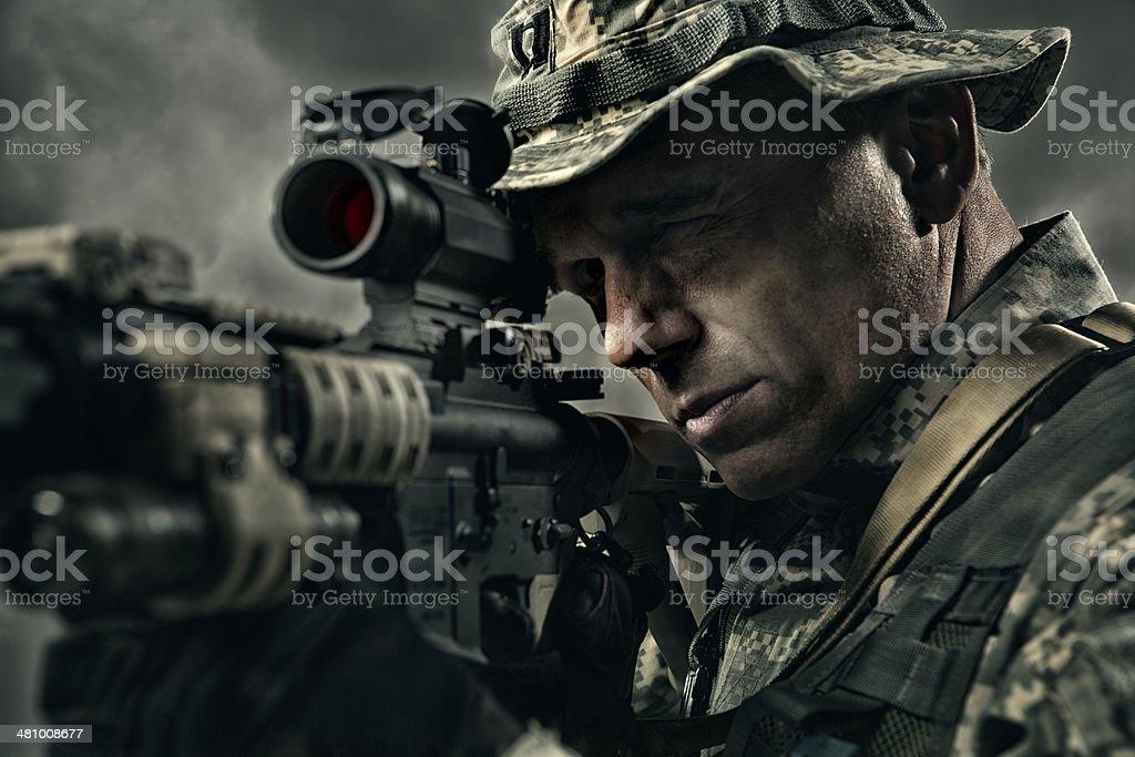Military Sniper prepares to take a shot stock photo