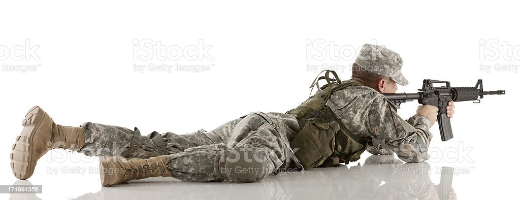 Military soldier aiming with M16 rifle royalty-free stock photo