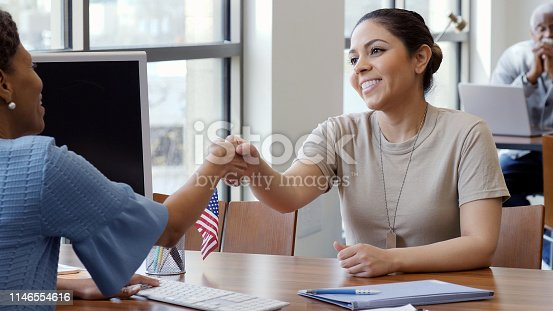 istock Military soldier greets bank loan officer 1146554616
