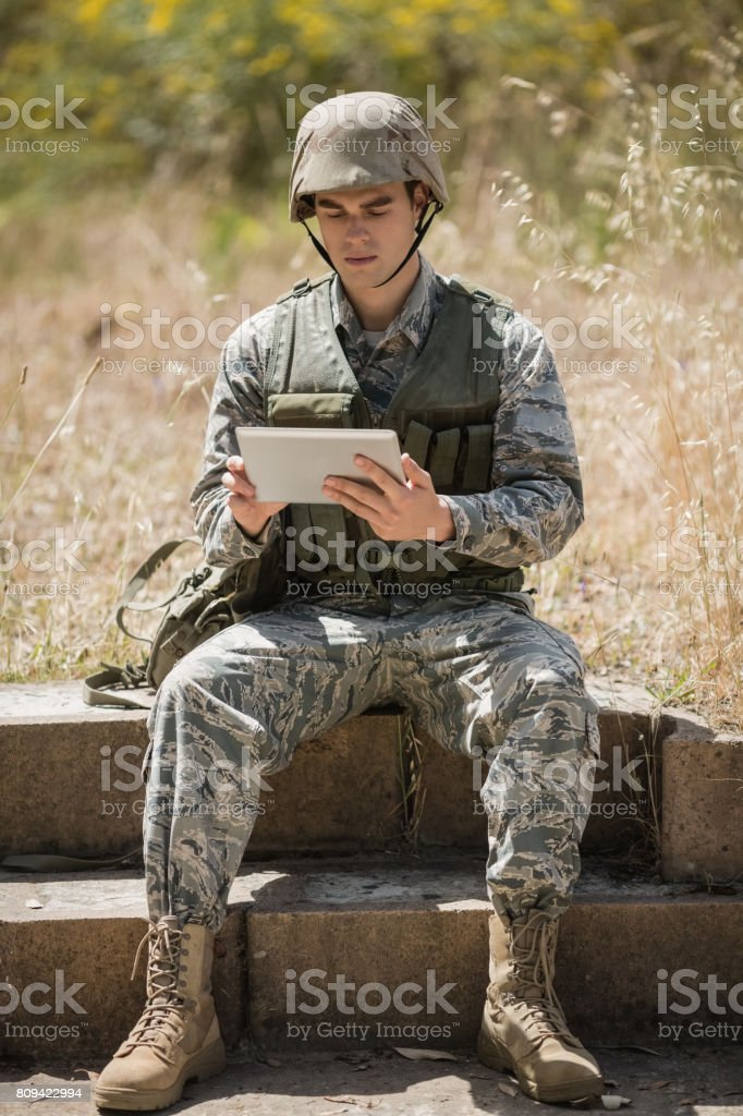 Military soldier using digital tablet stock photo
