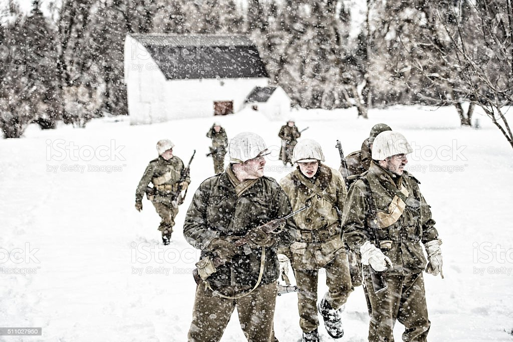 WWII US Military Squadron On Patrol In A Winter Blizzard stock photo