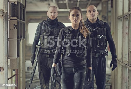 istock Military swat team members during operation in abandoned warehouse 533698754