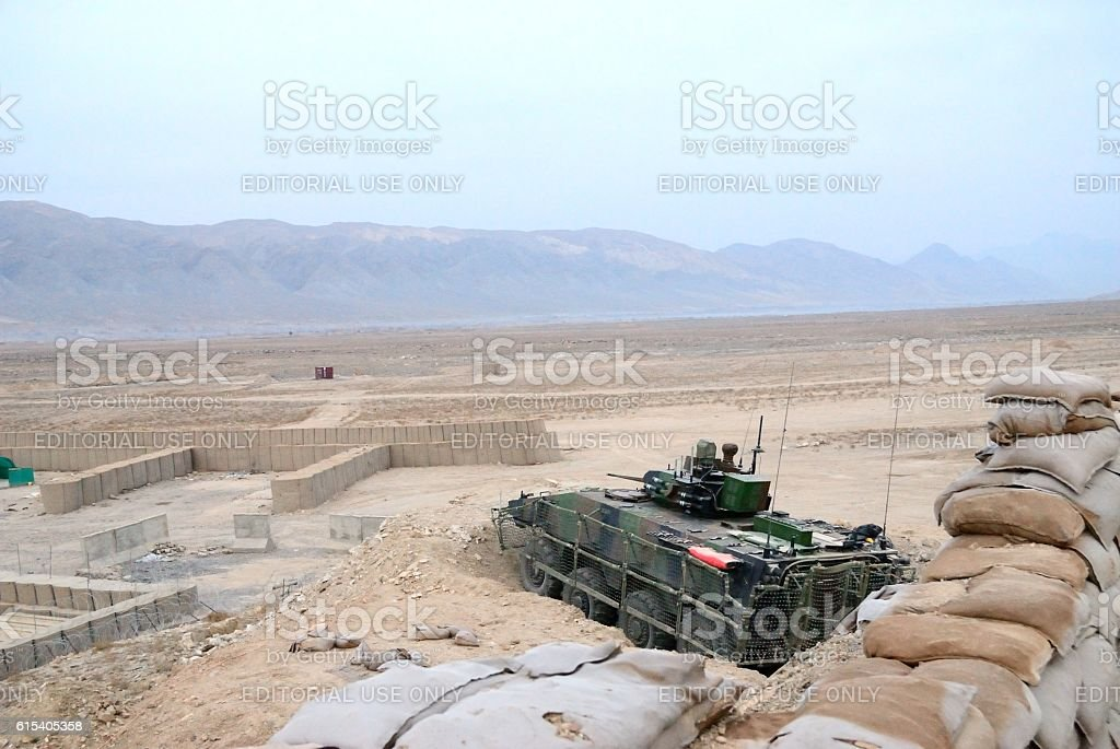 Military tank at battlefield stock photo
