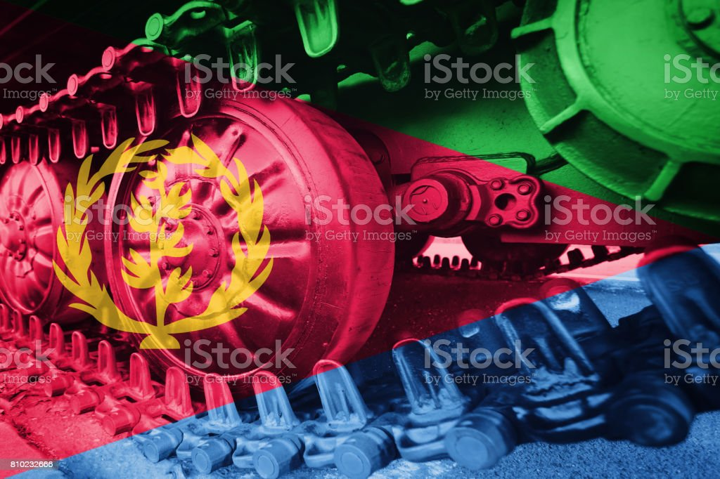 Military tank close-up Caterpillar Track with Eritrea flag Background. stock photo