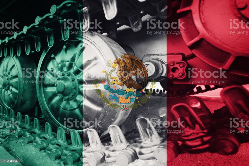 Military tank close-up Caterpillar Track with Mexican flag Background. stock photo
