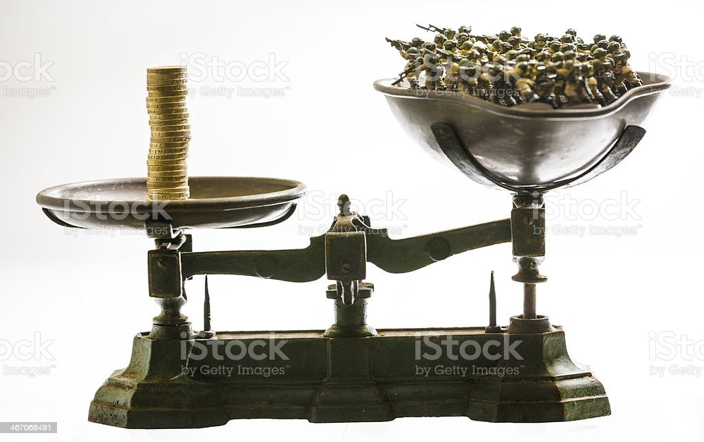 Military trade spending cost scales stock photo