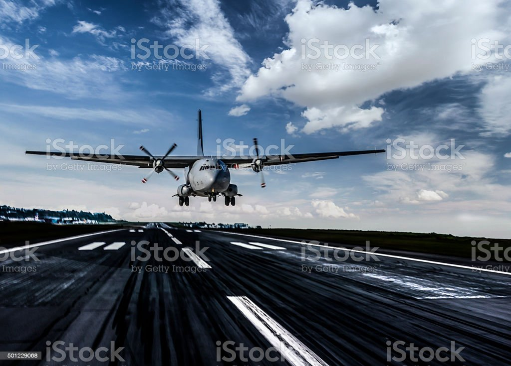 Military transport aircraft landing stock photo