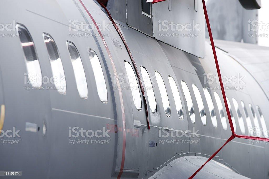 Military transport aircraft windows close-up royalty-free stock photo