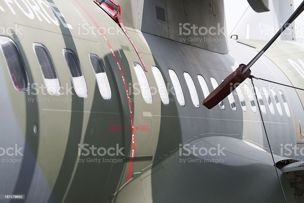 Military transport aircraft windows close-up royalty-free stock photo