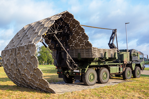 istock Military truck with folding street device of german army engineer battalion 1174409796