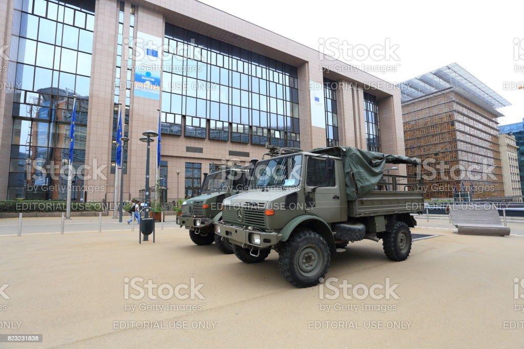 Military trucks opposite European Council building stock photo