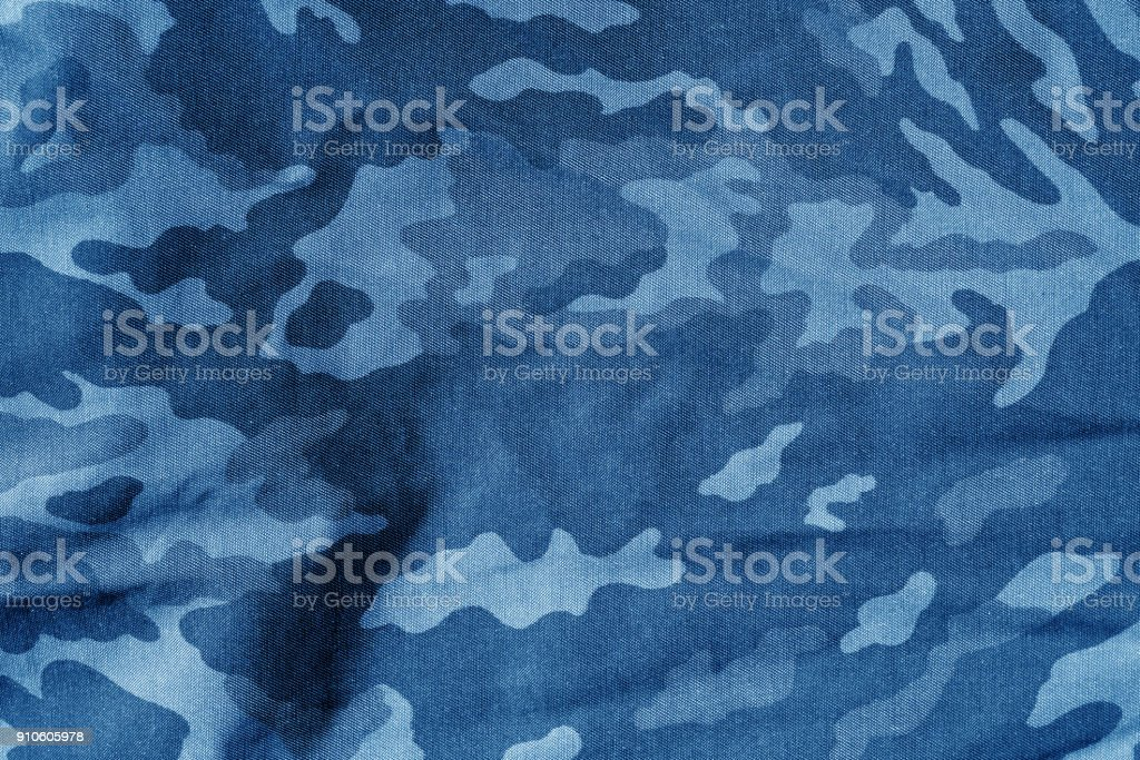 Military uniform pattern with blur effect in navy blue. stock photo