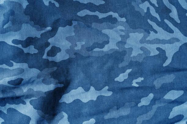 military uniform pattern with blur effect in navy blue. - kamuflaż zdjęcia i obrazy z banku zdjęć