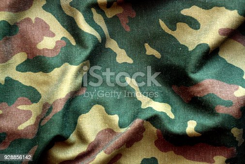 istock Military uniform pattern with blur effect. 928856142