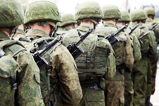 Military uniform soldier row Army parade - military force uniform soldier row march marching stock pictures, royalty-free photos & images