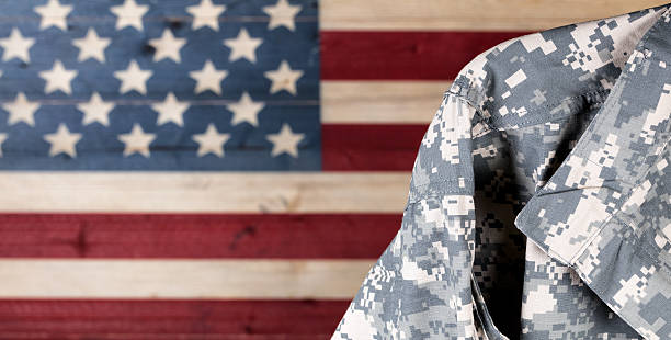 military uniform with faded boards painted in american usa flag - armed forces stock photos and pictures