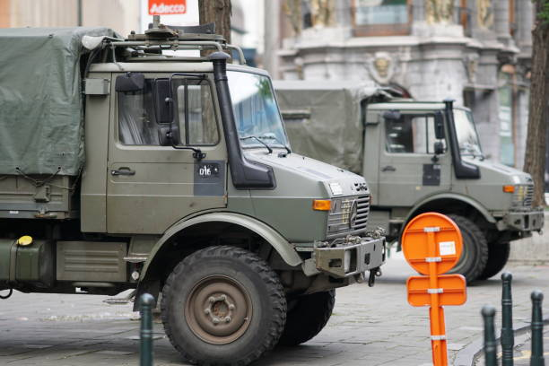 Military vans Brussels, Belgium - December 9, 2017: military vehicles parked in the city centre antiterrorist stock pictures, royalty-free photos & images