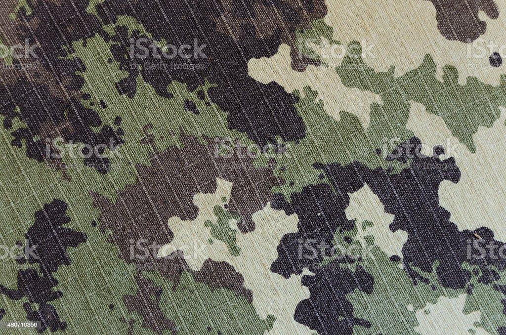 vegetato милитари камуфляжным rip ткани текстуры фона стоковое фото