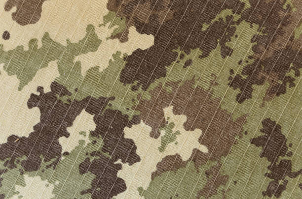Military vegetato camouflage rip-stop fabric texture background Military vegetato camouflage rip-stop fabric texture background camouflage stock pictures, royalty-free photos & images