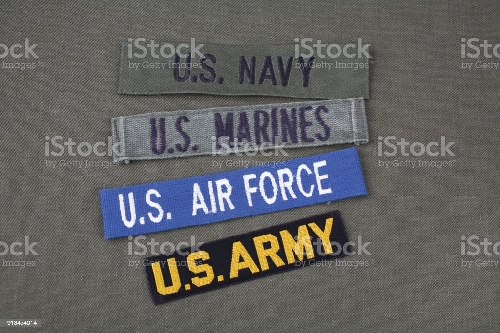 US military veteran concept on olive green uniform stock photo