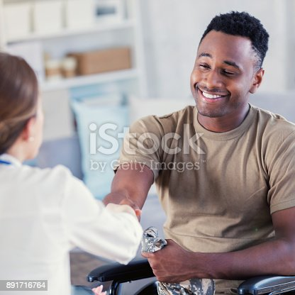 istock Military veteran shakes hands with therapist 891716764