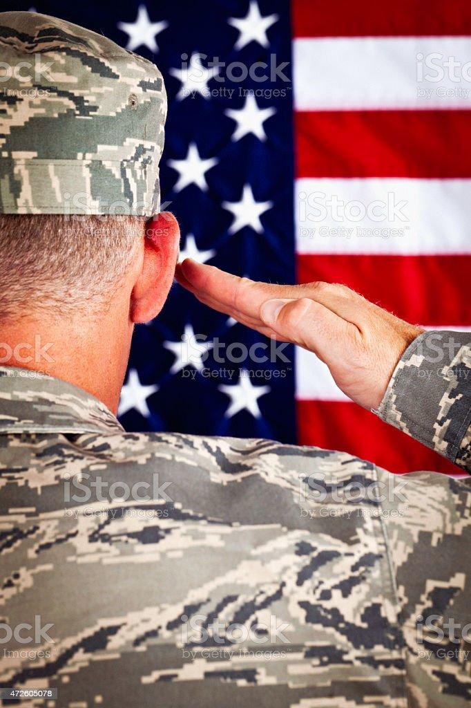 Military veteran soldier saluting American flag. Patriotism. US Armed Forces. stock photo