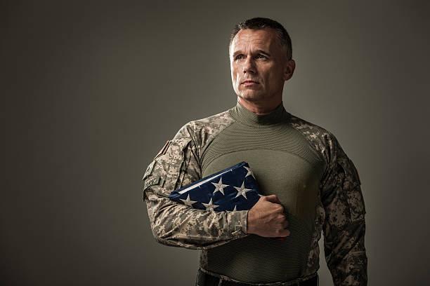 Military Vetran Honoring Fallen Heros stock photo