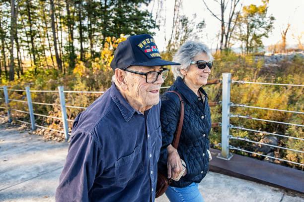 Military war veteran father and daughter walking picture id1094290730?b=1&k=6&m=1094290730&s=612x612&w=0&h=as5f9etma06axs4bepgmp8v44kg3r7h7e8z7hog3ga8=