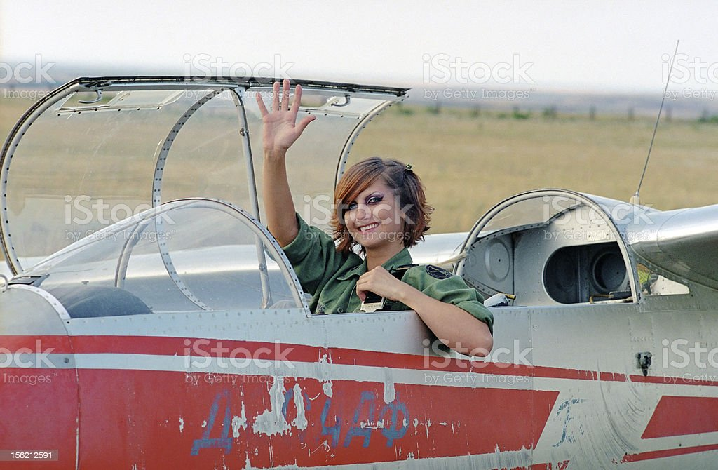 military woman sitting in glider stock photo