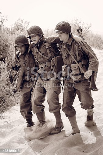 1143756392 istock photo 3 military WW2 in a combat zone 453489915