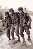 3 military WW2 in a combat zone
